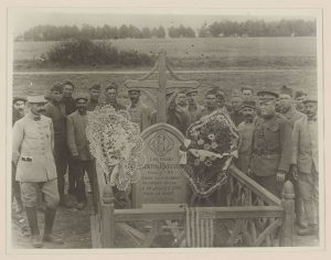 Soldiers gather by the grave of Lt. Quentin Roosevelt, killed in aerial combat in 1918.