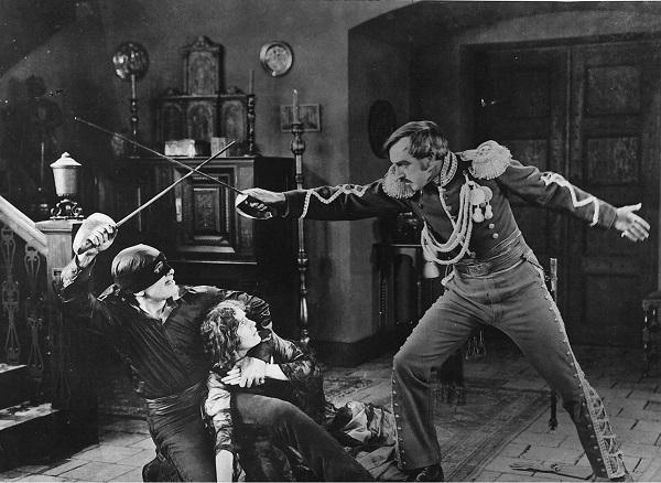 The Mark of Zorro Douglas Fairbanks as Zorro protects Lolita (Marguerite De La Motte) while he dueling Capitán Ramon (Robert McKim). Library of Congress.
