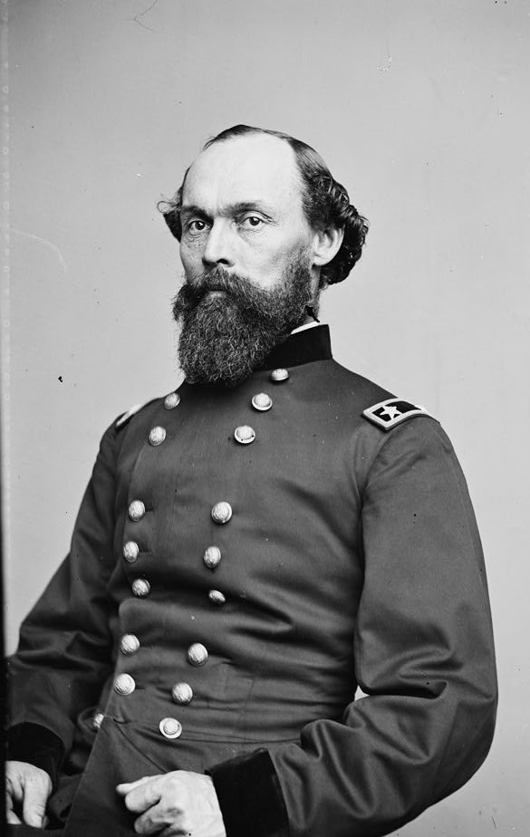 Maj. Gen. George Granger, trim, bearded and balding, sits for a portrait in his military uniform.