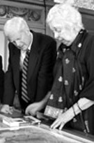 Marie Tharp wearing a dark dress and former Librarian of Congress James Billington in a suit and tie, in a 1999 black and white image