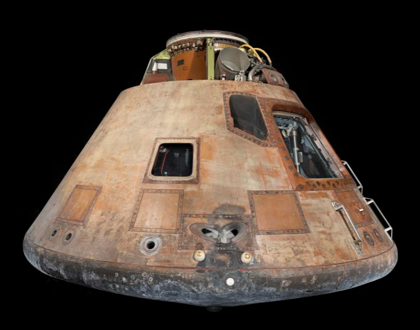 The Apollo 11 command module photographed against a black background.